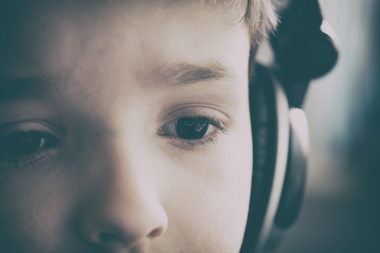 Autism. Child wearing headphones to show hyper sensitivity to sound